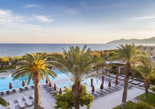 Collection of Doryssa luxury hotels in Samos main pools surrounded by palm trees