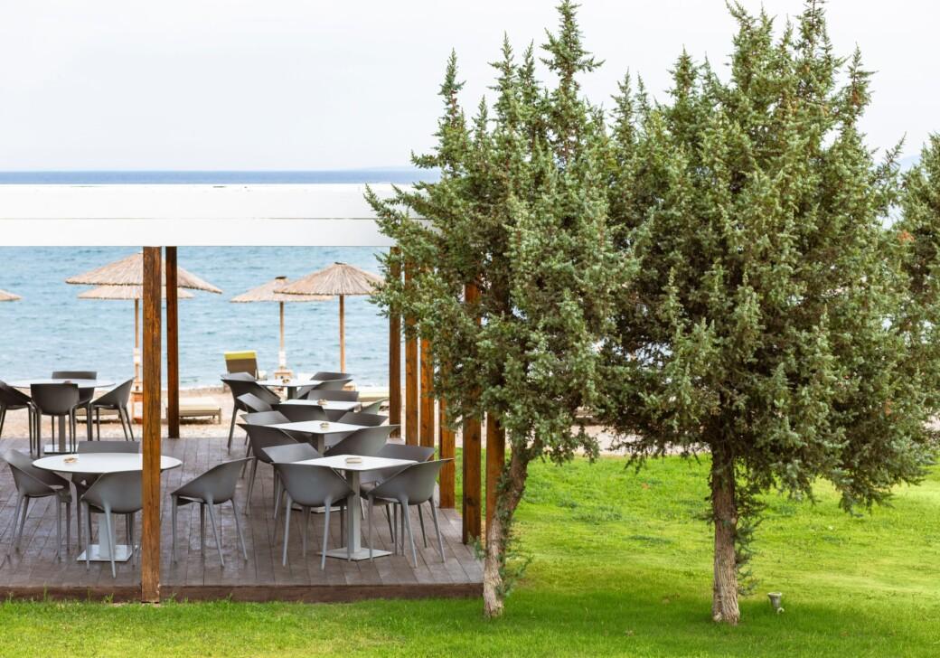 The al fresco beach bar at Doryssa Coast's beachfront luxury apartments in Samos