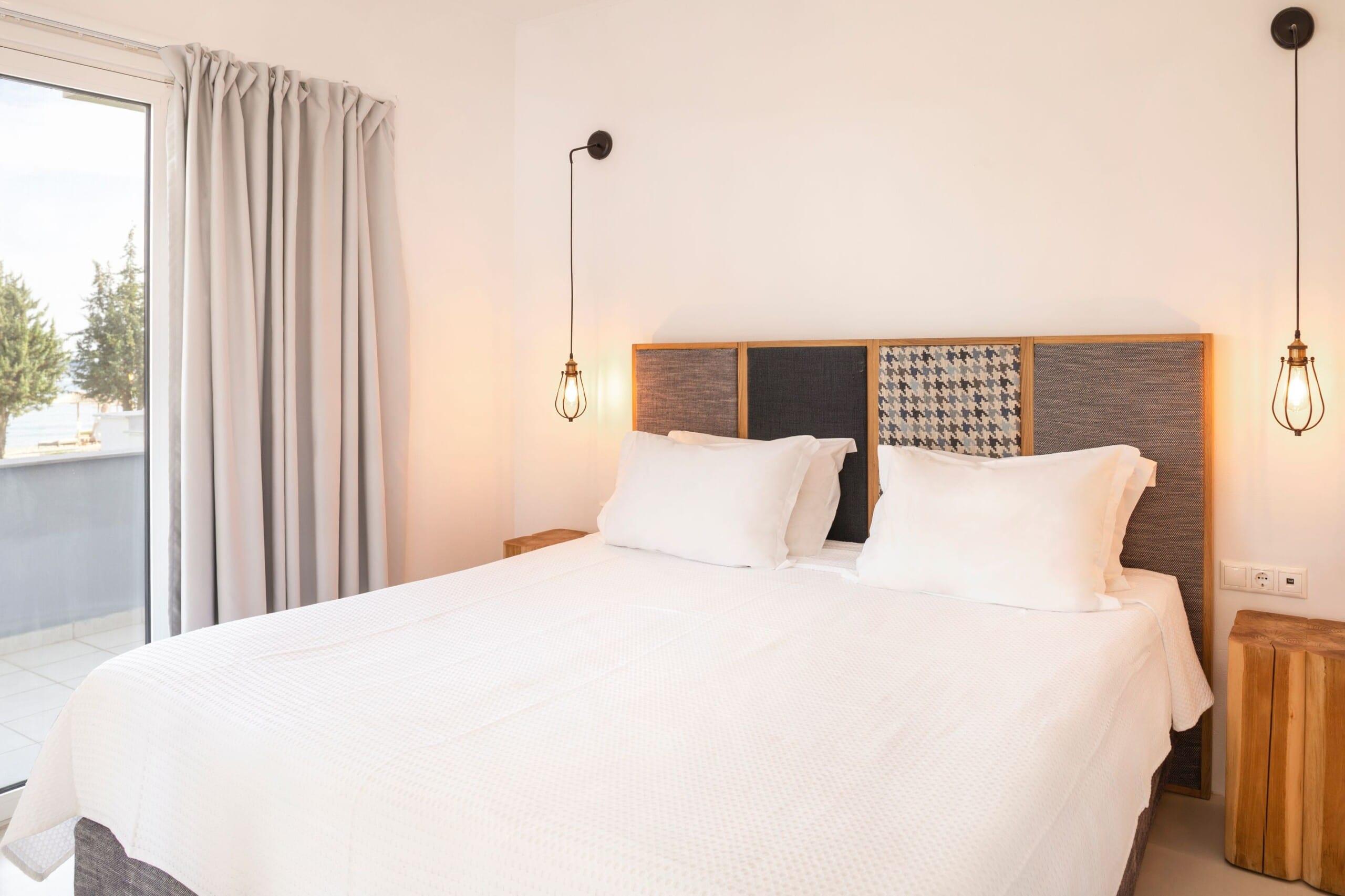 Bedroom of Doryssa Coast's seaview apartments in Samos