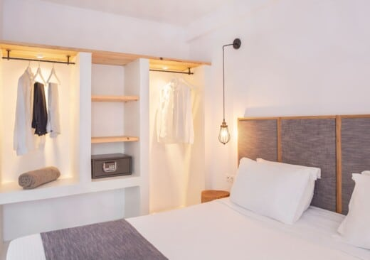 Bedroom and open wardrobe of Doryssa Coast's family apartments in Samos