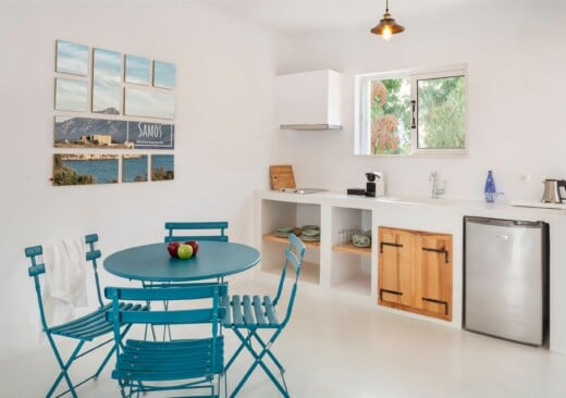 Living room and kitchenette at Doryssa Coast's family apartments in Samos