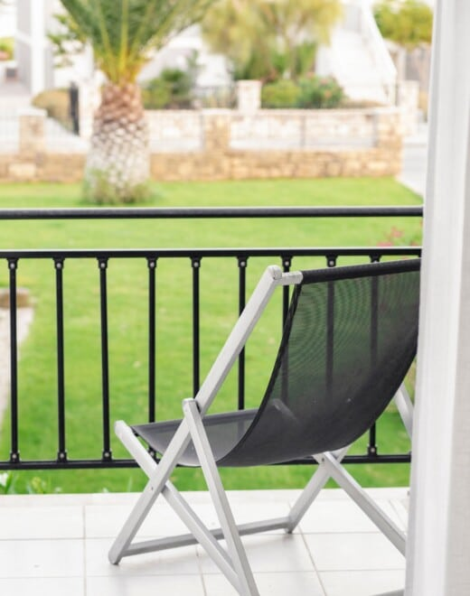 Chaise longue in balcony overlooking the lawn at Doryssa Coast's family apartments in Samos family apartments in Samos