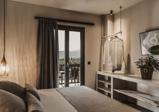 Bedroom and open wardrobe and dresser at Doryssa Boutique Hotel, suitable couples accommodation in Samos