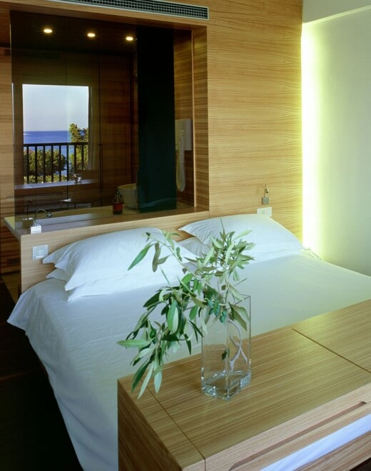 The bedroom of Doryssa Seaside's hotel room for two guests