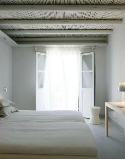 The bedroom of the Junior Suite of Doryssa Seaside Village is a delightful family seaview suite in Samos
