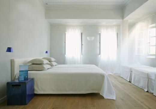 The bedroom of the Junior Village family room garden view in Samos by Doryssa Seaside