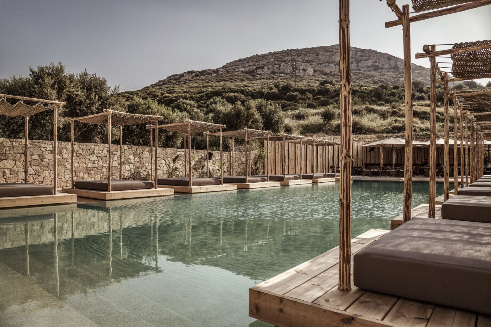 The boho chic pool of Doryssa Boutique Hotel, part of the group's luxury hotels in Samos